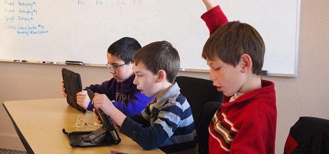 Photo of 3 school boys in the classroom