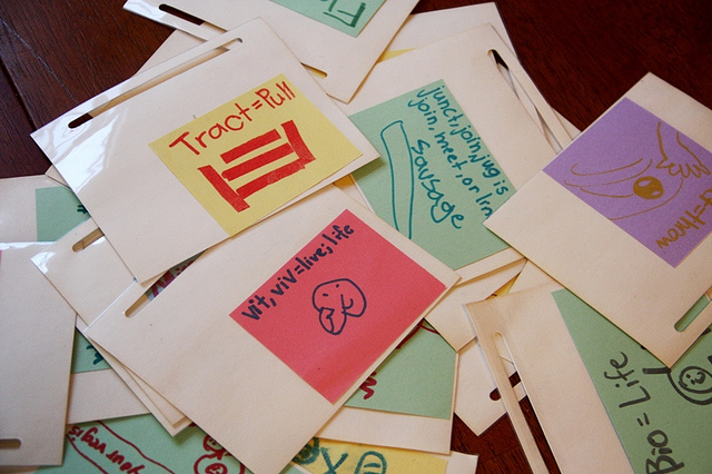 Colourful flashcards spread out on a table