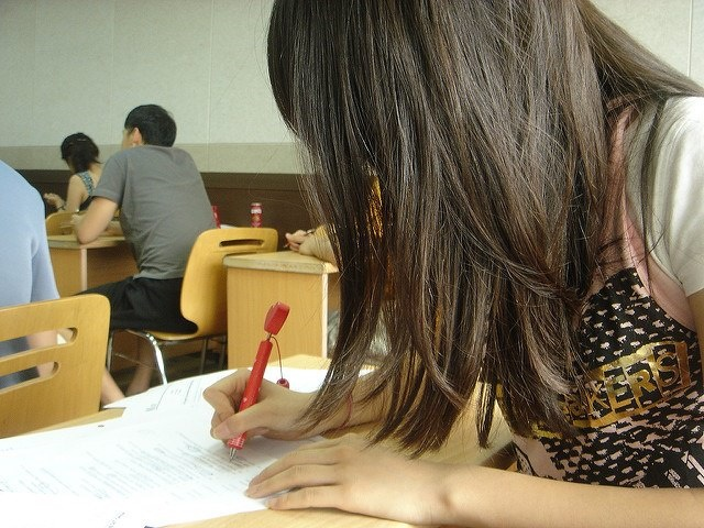 Girl studying for an exam in school