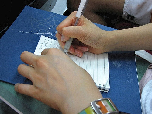A person taking notes