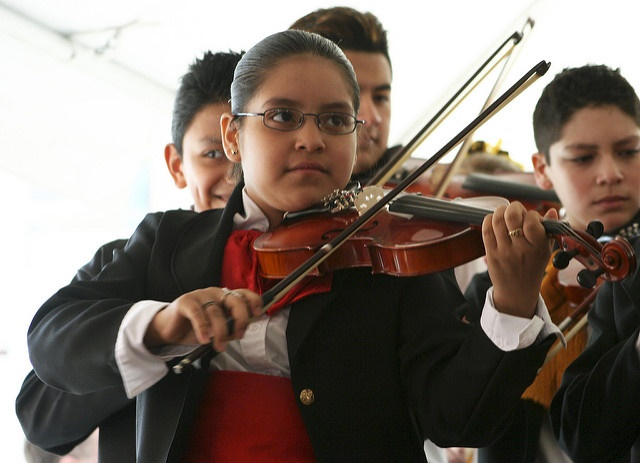 School pupil playing the violin