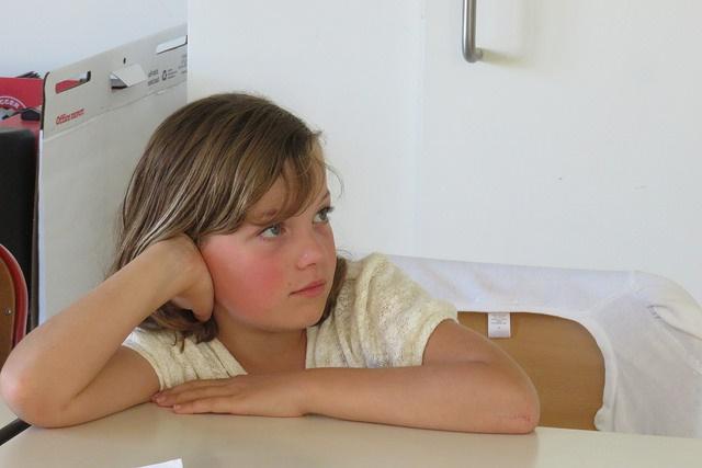 School girl sitting at a desk