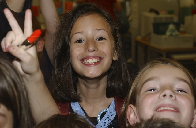 Girl in a classroom smiling