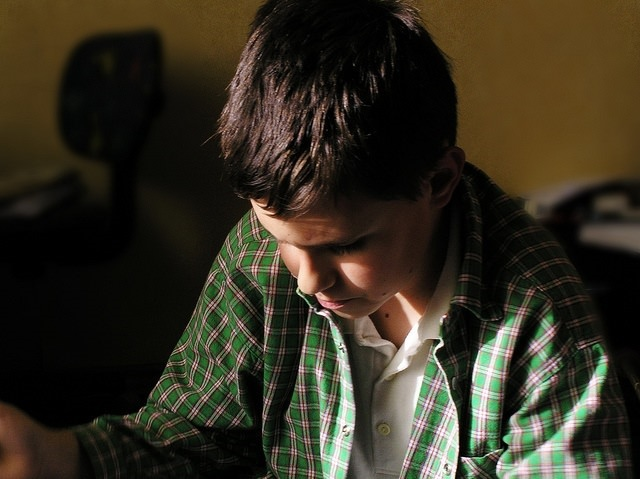 Photo of a boy studying