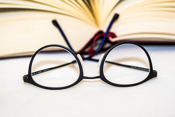 Photo of glasses and a book