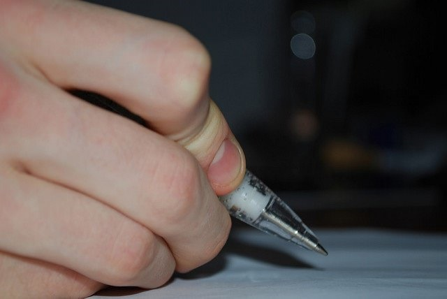 Photo of someone holding a pen