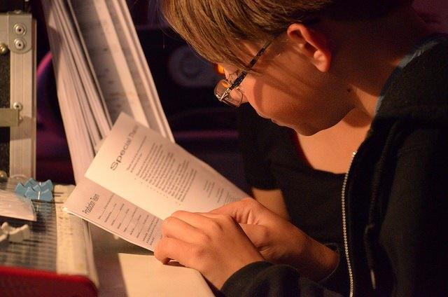 Photo of a boy reading a book