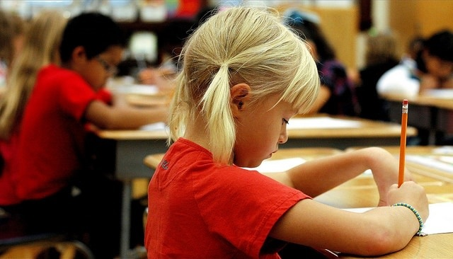 Photo of a girl in a red t shirt in the classroom