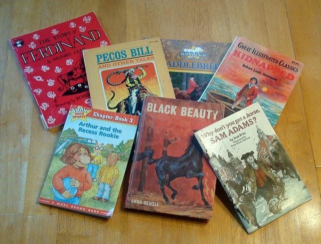 Photo of children's books on a desk