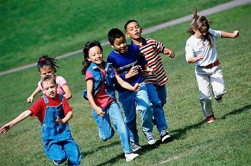 Photo of kids running on grass