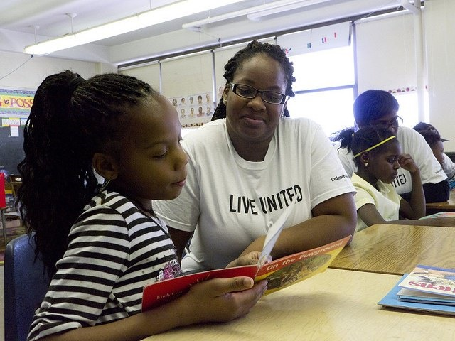 Photo of a student and teacher reading