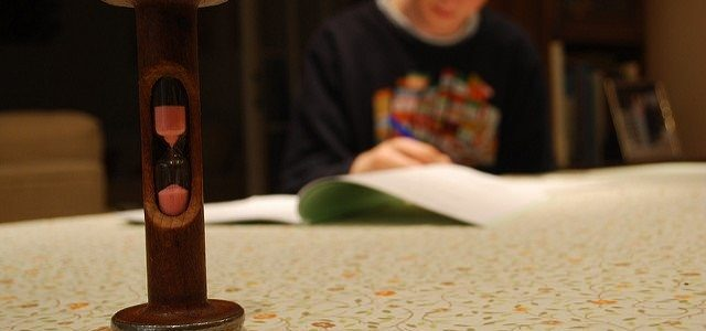 Photo of a boy studying with an egg timer