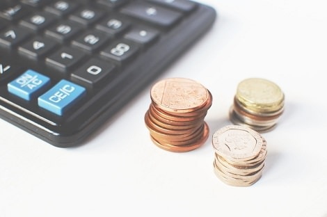 Photo of coins and a calculator