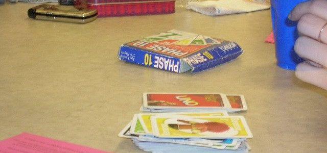 Photo of a card game on a table