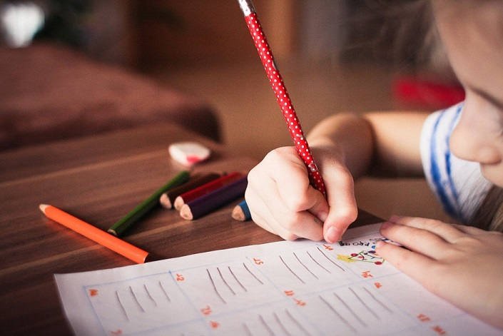 Photo of a child drawing on paper