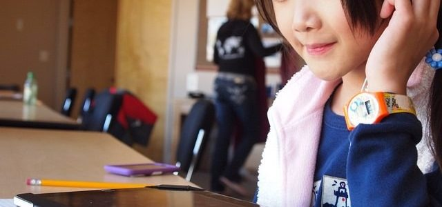 Photo of a girl studying on an ipad