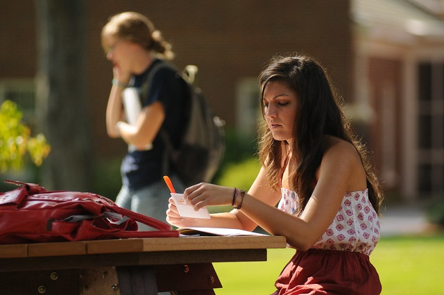 Photo of a girl studying outdoors