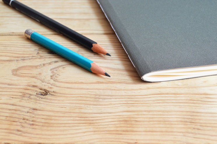 Photo of two pencils and a notepad